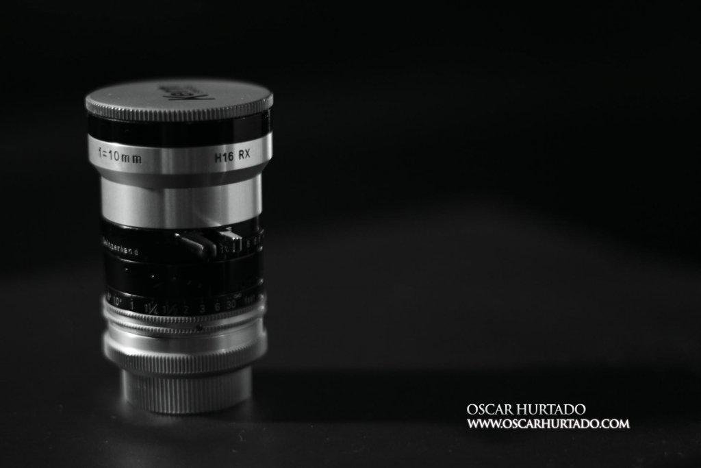 Kern Switar 10mm f1.6 preset C-mount lens standing on rear cap