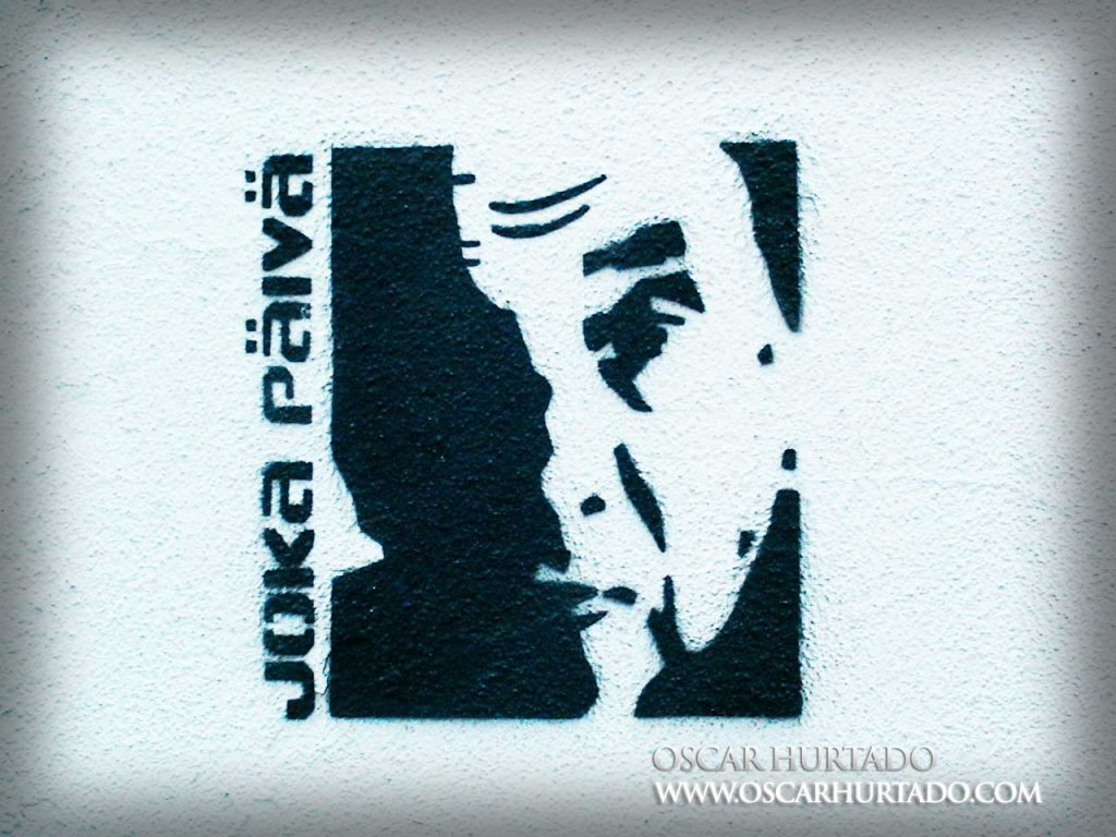 Black minimalistic stencil graffiti by Joka Päivä of a portrait of the Dalai Lama