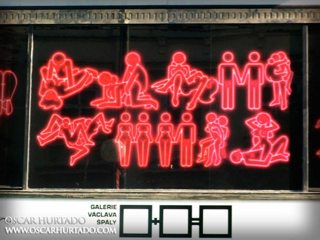 The neon red Main Panel of a Sex Exhibition taking place in Národní street at the Václava Špály Gallery