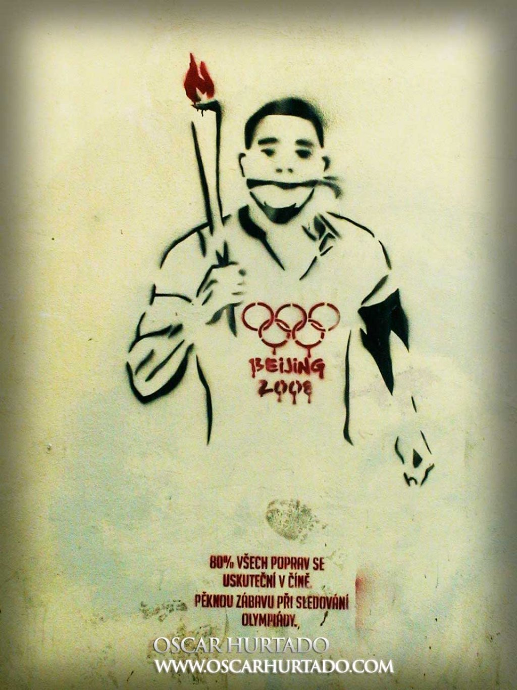 Black and red graffiti of an Olympic athlete with the Beijing 2008 logo bleeding on his chest due to human rights abuses during the preparations for the games