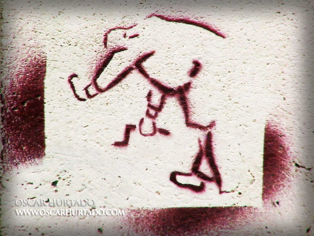 Graffiti of a business man in some bizarre action