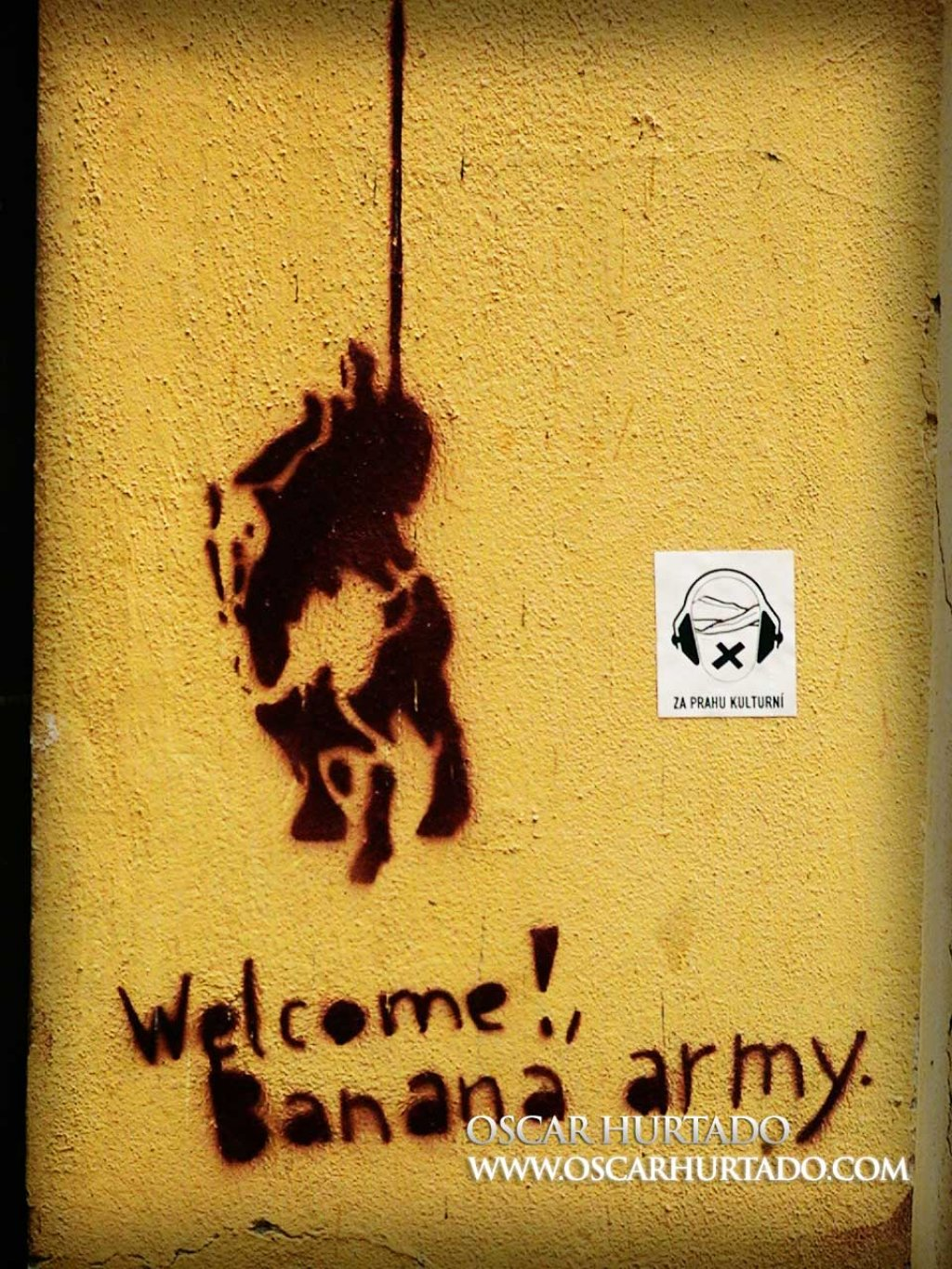 Graffiti portraying Don Quixote and the Banana Army sign