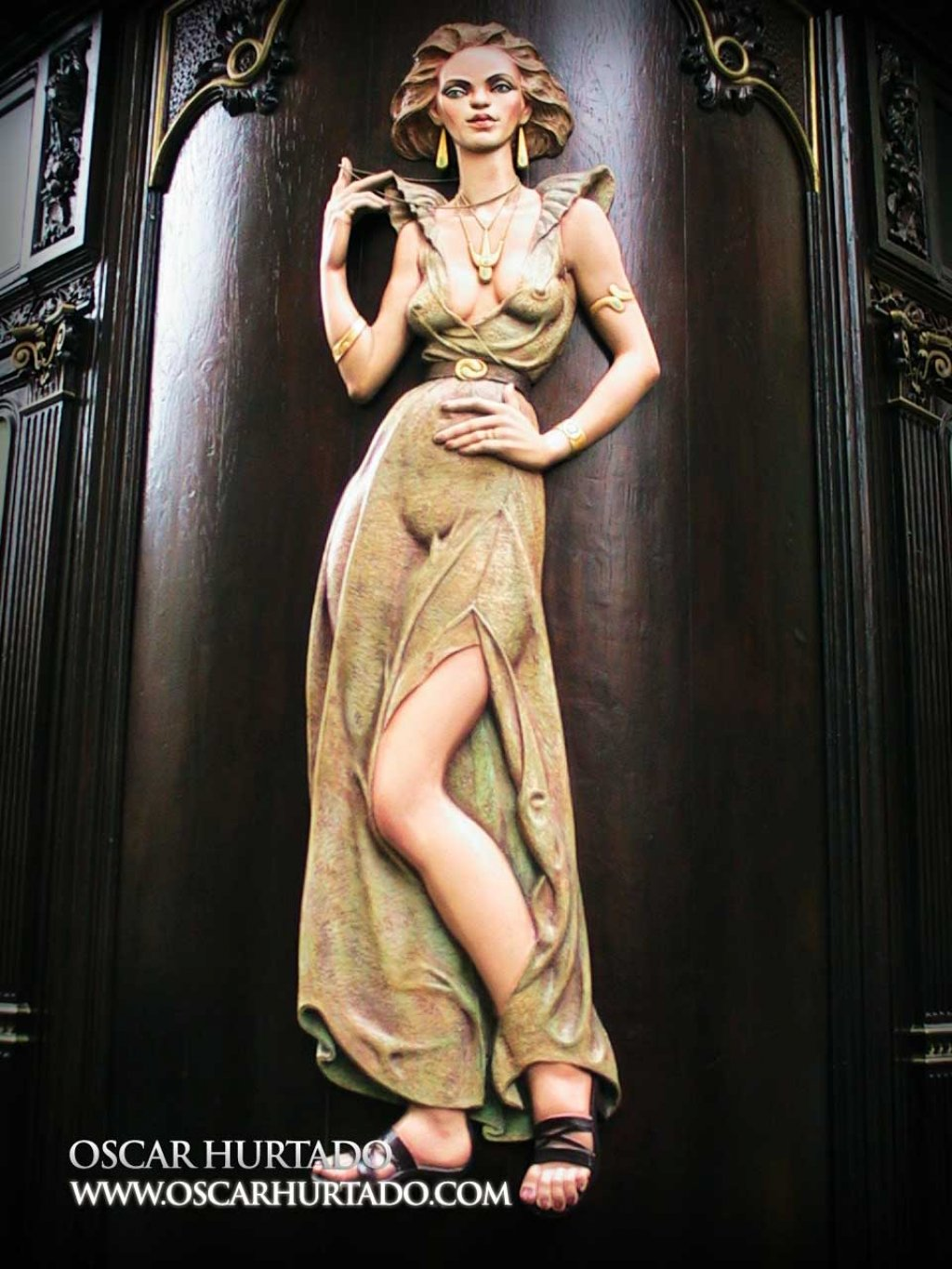 The iconic and beautiful wooden carved woman found on the façade of the Cafe-Restaurant Prague