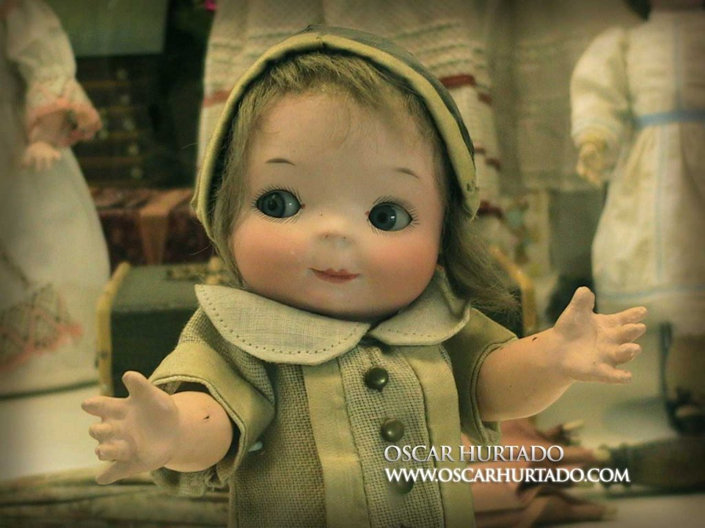 Medium closeup of a beautiful and cute antique doll found in the Toy Museum of Prague