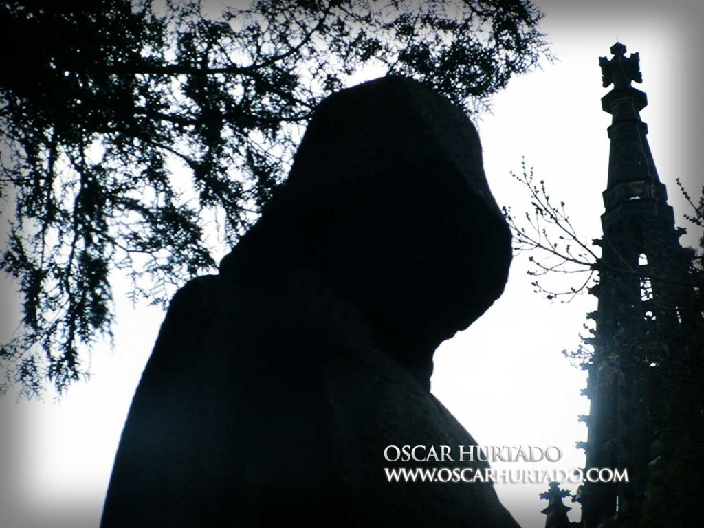 Contrasty shot of the dark silhouette of a statue from the Vyšehrad cemetery