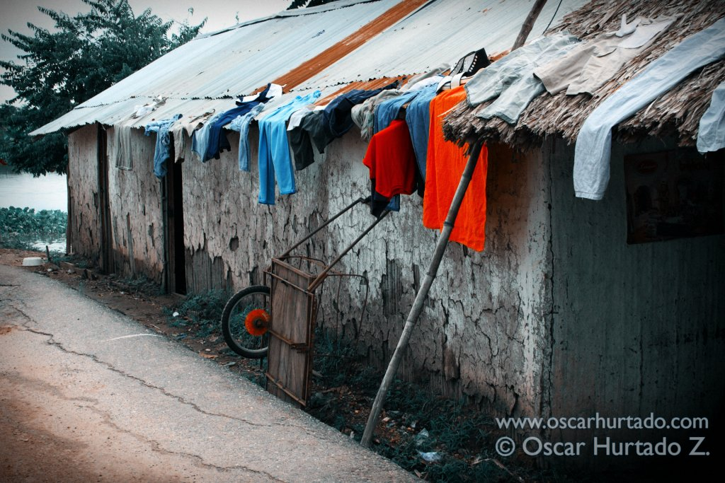 A collection of clothes drying up on the roof of a home by the flooded shores of the Magdalena river