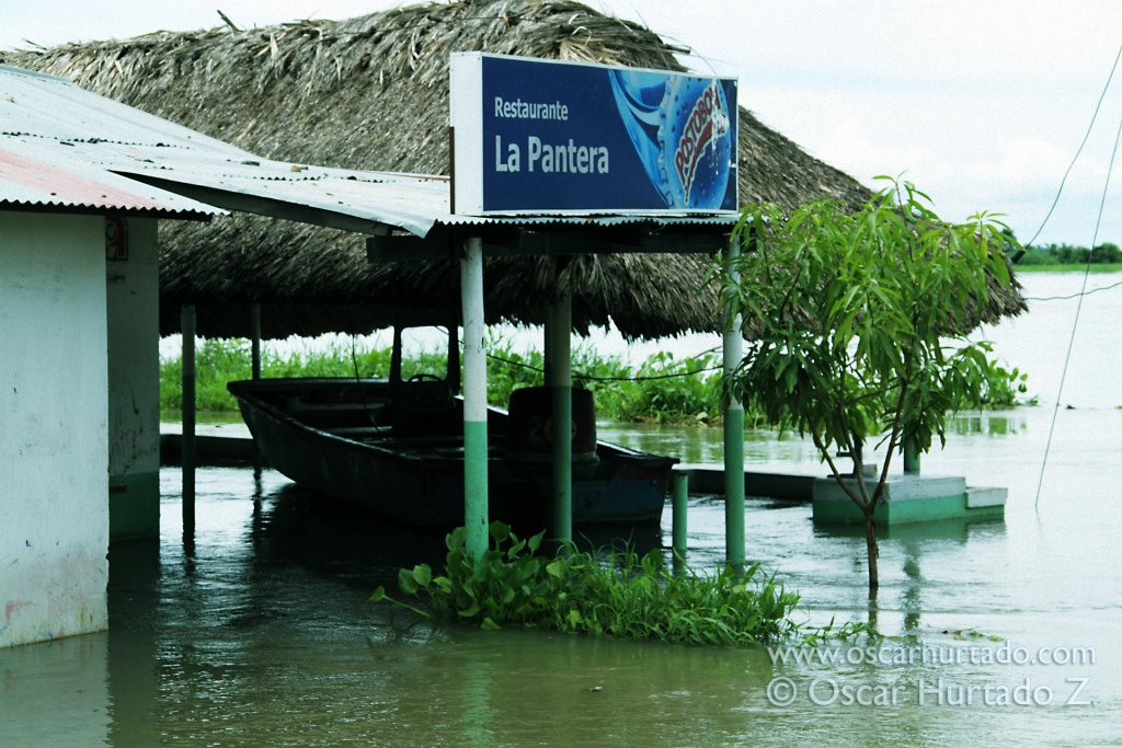 A boat floats inside a flooded restaurant during the rainy season hitting the Magdalena region
